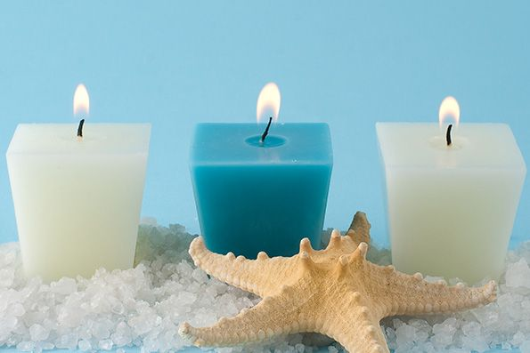 burn an ocean scented candle to evoke the full experience of living by the beach