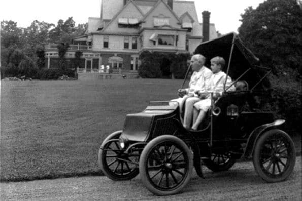 Thomas Edison with his son in a car near his home