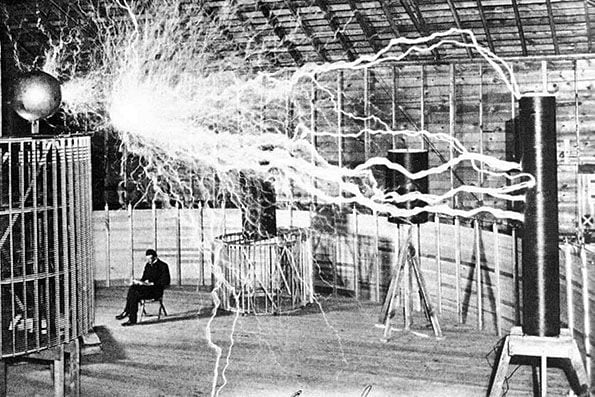 the most lasting image of Tesla may be of the wizard reading a book in a lab chair as electrical bolts arc around him. In those two photos lay the first secret of the two inventors: While one is holding a marketable commodity, the other is scaring the kids. People want light bulbs in their homes—they don't want lightning