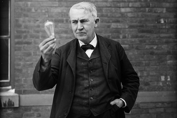 Thomas Alva Edison Holding a Lightbulb