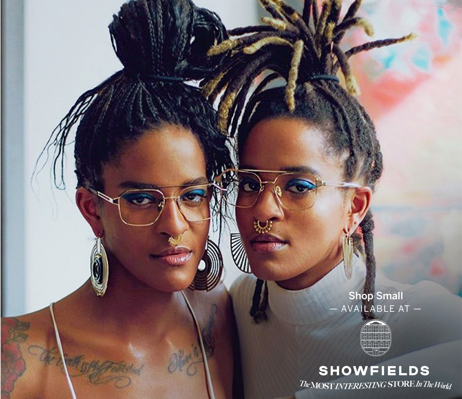 Two women posing and wearing their company eyewear